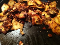 Toasted almonds and pita bread dressed with sumac and chili flakes