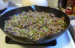 Sausage, onion, celery and parsley at work