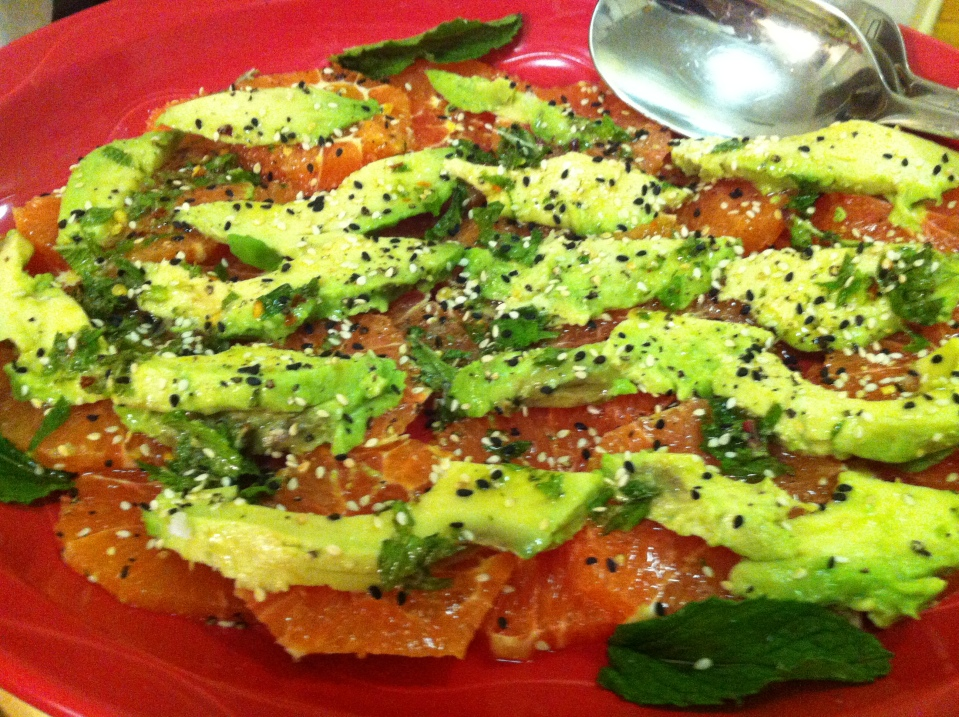 Blood orange and avocado salad with mint, sesame seeds, and lime
